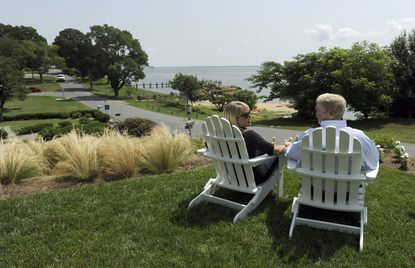 Alex and Wendy Haig enjoy their front lawn's view, which faces the Chesapeake Bay.