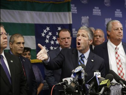 Patrolman's Benevolent Association President Patrick Lynch, center, gestures as he speaks during a news conference at PBA headquarters last year in New York, following a decision to terminate NYPD Officer Daniel Pantaleo, who was involved in the chokehold death of Eric Garner in 2014.