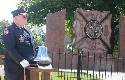 Lutherville Volunteer Fire Company member James Doran rings the memorial bell as each of 43 names of fallen firefighters is read. The Baltimore County Fire Service hosted its annual Ceremony of Remembrance May 20 at the fire memorial at Patriot Plaza in Towson.