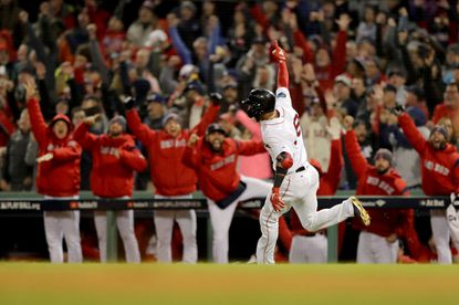 The dugout reacts as Eduardo Nunez #36 of the Boston Red Sox celebrates his three-run home run during the seventh inning against the Los Angeles Dodgers in Game 1 of the 2018 World Series at Fenway Park on October 23, 2018 in Boston.