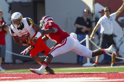 Maryland wide receiver Juwann Winfree scores a touchdown after a reception as Tegray Scales of Indiana tries to defend at Memorial Stadium.