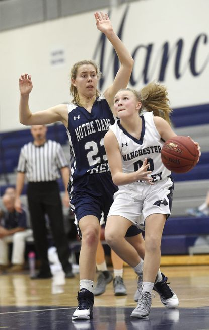 Nortre Dame Prep's Mary Price Suter defends Manchester Valley's Josey Klingenberg as she goes for a layup in a scrimmage Nov. 29.