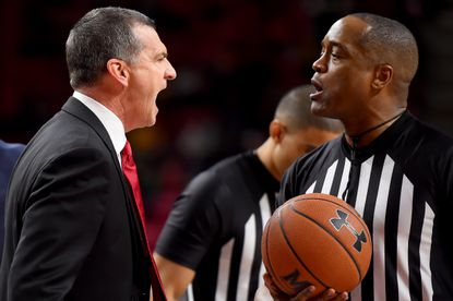 COLLEGE PARK, MD - DECEMBER 29: Head coach Mark Turgeon of the Maryland Terrapins reacts to referee Earl Walton after a play against the Bryant University Bulldogs during the second half at Xfinity Center on December 29, 2019 in College Park, Maryland. (Photo by Will Newton/Getty Images)