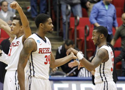 Mississippi's Aaron Jones (34) and Jarvis Summers celebrate after beating Brigham Young 94-90.