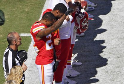 Kansas City Chiefs cornerback Marcus Peters raises his fist in the air during the national anthem before an NFL football game against the San Diego Chargers on Sunday, Sept. 11, 2016, in Kansas City, Mo.