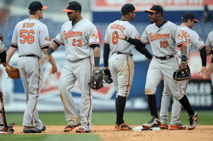 The Orioles celebrate after defeating the New York Yankees, 14-5, on April 8 at Yankee Stadium.