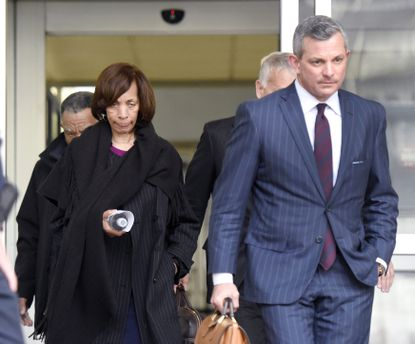 In this Nov. 21, 2019, file photo, former Baltimore mayor Catherine Pugh, left, leaves U.S. District Court in Baltimore with her attorney Steven Silverman. The disgraced former mayor of Baltimore is scheduled to be sentenced during a hearing on Thursday, Feb. 27, 2020.