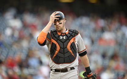 Baltimore Orioles catcher Matt Wieters (32) adjusts his helmet during an interleague baseball game against the Washington Nationals, Thursday, Sept. 24, 2015, in Washington. The Orioles won 5-4.