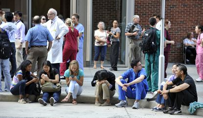 People were evacuated from buildings including the University of Maryland School of Dentistry on West Baltimore Street after a 5.8 magnitude earthquake centered in Mineral, Va., was felt in Baltimore.