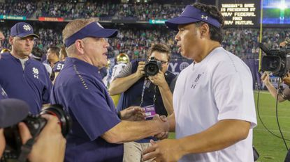 Notre Dame head coach Brian Kelly, left, shakes hands with Navy counterpart Ken Niumatalolo following the 2018 game between the schools that was held in San Diego. The Navy-Notre Dame series, which has been held annually since 1927, will be paused in 2020.