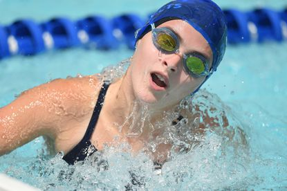 Five Oaks swimmer Paige Adelsberger, shown swimming in the Barracudas only loss of the season against Dulaney, won three races in the 15-18 age groups on July 15 as Five Oaks defeated Nottingham, 248-233.