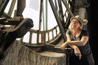 Baltimore artist Kelley Bell, 40, has created astrologically inspired projections for each of the four clock faces of the Bromo Seltzer Tower.