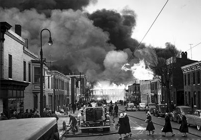 The 18-alarm fire in Canton in February 1953 raged through lumber yards, marine repair yards and canning operations.