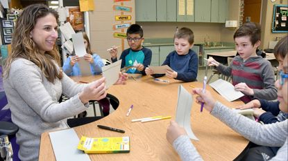 Teresa Beilstein, a third-grade teacher at South Shore Elementary School, in a group with her students. She was named Anne Arundel County Teacher of the Year Thursday night.