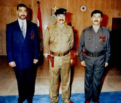 This is an undated file photo of Saddam Hussein with his sons, Odai, left, and Qusai.