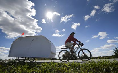 William Cassidy pulls his homemade camper as he bikes along Md. 26 in Winfield Thursday, Oct. 8, 2020. Cassidy, of Delaware County, Pa., started his trek in Fallston about 20 days ago and plans to head south, maybe to Florida, for the winter months. Cassidy, who said he's always liked to travel, built the camper, which he tows with his bike and has everything he needs in it, from lightweight coroplast. About 100 miles into his journey, he said it's been a fun trip so far, not always easy, but that the people he's met along the way have really made it worthwhile.