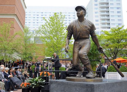 Hall of Fame former Oriole Frank Robinson speaks after the team unveiled a statue of him at Camden Yards. It is one of six statues of the team's Hall of Famers to be unveiled at the stadium this season.