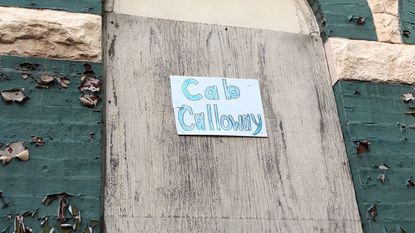 "A sign that reads ""Cab Calloway"" hangs on the front of the house where he used to live at 2216 Druid Hill Avenue in Baltimore."
