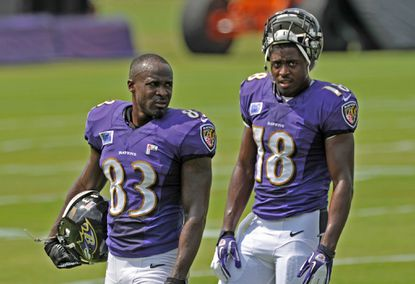 Deonte Thompson (left) looks on during a training camp practice.