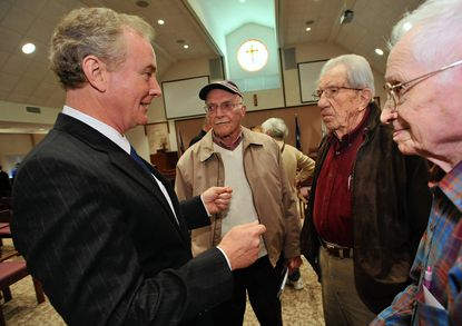 Rep. Chris Van Hollen, left, chats with residents at Carroll Lutheran Village.
