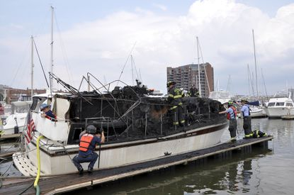 40-foot boat catches fire in Canton marina