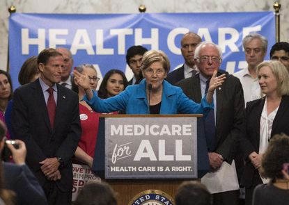 """Medicare for All is a political proposal that could mean a government-run, single-payer health care system, or a system allowing Americans to buy into Medicare at age 50, also called Medicare for More. It differs from the Affordable Care Act, which left private insurers paramount. <p>You may also like: <a href=""""https://thestacker.com/stories/3221/lgbtq-history-stonewall"""">LGBTQ+ history before Stonewall</a></p>"""
