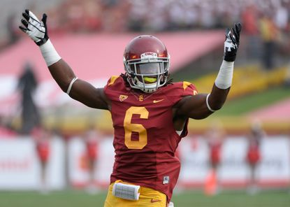 USC safety Josh Shaw pumps up the crowd during a 2013 game against Utah.