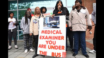 In front of the Medical Examiner's Office, the family of Tyrone West demands his case be reopened