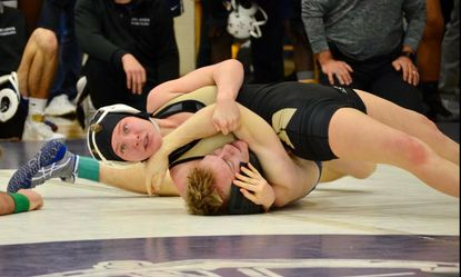 Julianne Moccia finishes off one of her 69 pins as a John Carroll wrestler.