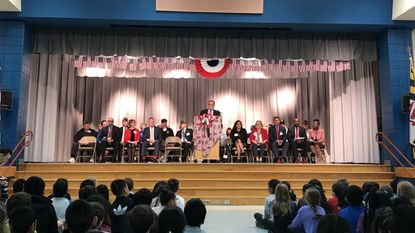 Veterans Elementary School Principal Robert Bruce welcomes students, staff, veterans and honored guests to Friday's ceremony.