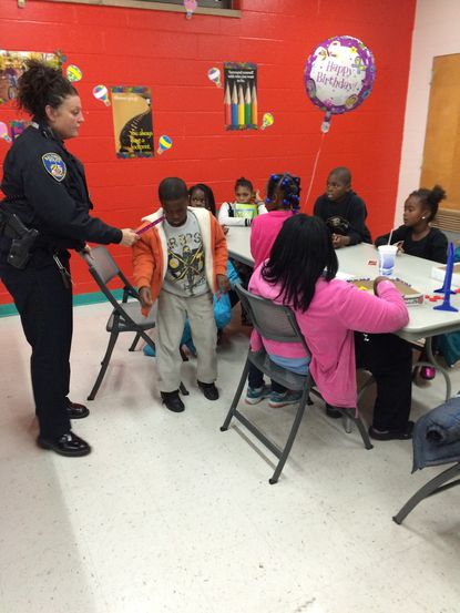 An officer disciplines a child at the east side Youth Connection Center.