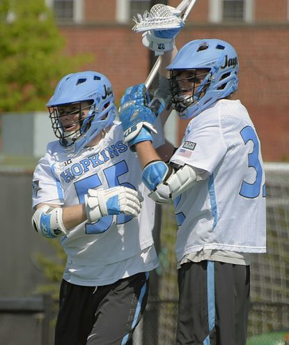 Johns Hopkins midfielder Joel Tinney, left, celebrates his goal against Penn State with attackman Shack Stanwick during the second quarter at Homewood Field on April 15, 2017. Hopkins held on to beat Penn State, 13-11.