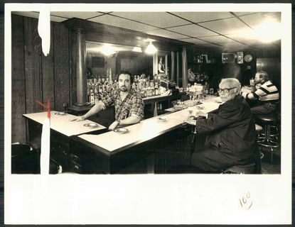Peter Denzer (left ) tends bar and atmosphere at his bar, Peter's Inn, in this 1979 photo