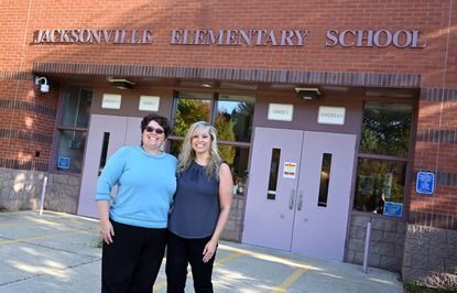 Jacksonville Elementary School Principal Debbie Miller, left, and Assistant Principal Marlana Mathis pose in front of the school, which recently was named a National Blue Ribbon School by the U.S. Department of Education.