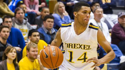 Calvert Hall graduate Damion Lee, shown playing for Drexel against Towson, has decided to transfer to Louisville for his final year of college eligibility.