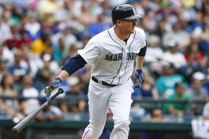 Seattle Mariners' Mark Trumbo watches his sacrifice fly during the fourth inning against the Texas Rangers, Saturday, Aug. 8, 2015, in Seattle.