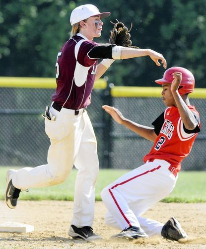Boys' Latin second baseman Stuart Reid, left, attempts to turn a double play as Friends' Chandler Walters was called for runner's interference in the Quakers' 5-2 victory.