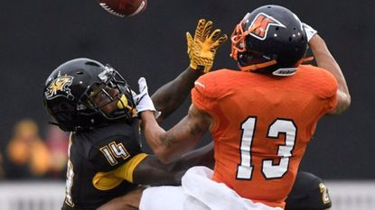 Towson defensive back Tyron McDade, left, intercepts a pass intended for Morgan State wide receiver Manassah Bailey in the first half of a college football game.