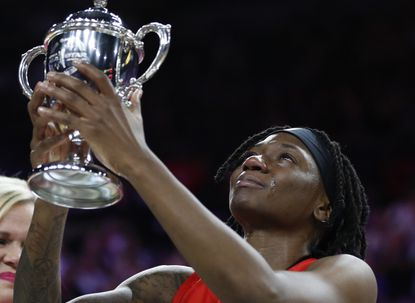 Indiana Fever's Erica Wheeler, of Team Wilson, cries as she holds up the MVP trophy after winning the honor at the WNBA All-Star game Saturday, July 27, 2019, in Las Vegas.