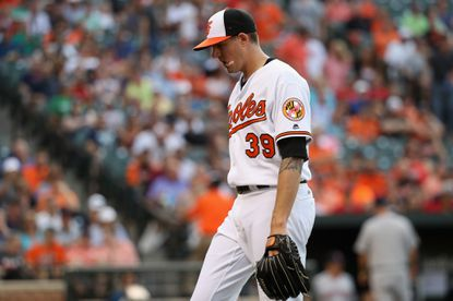 Starting pitcher Kevin Gausman #39 of the Baltimore Orioles walks to the dugout after the end of the second inning against the Boston Red Sox at Oriole Park at Camden Yards on May 31, 2016 in Baltimore, Maryland.