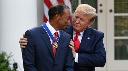 Plenty of athletes are refusing to stand with Trump - not Tiger Woods.