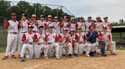 The Centennial baseball team poses for a photo after clinching the Howard County championship after its 7-5 win over visiting Howard on Tuesday, June 1.