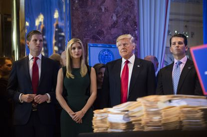 President-elect Donald Trump, Eric Trump, left, Ivanka Trump and Donald Trump Jr. listen during a press conference at Trump Tower in New York on Jan. 11, 2017.