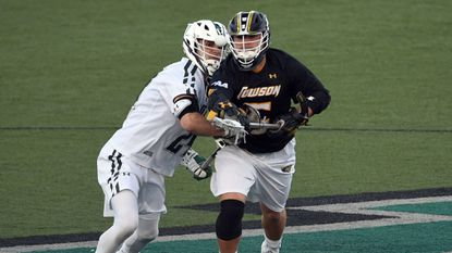 Senior faceoff specialist Mike Orefice (white jersey, pictured here against Towson on Feb. 28, 2018) was part of a critical run in the third quarter that propelled the Loyola Maryland men's lacrosse team to its fourth Patriot League title.