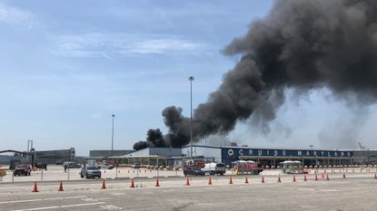 Black smoke could be seen billowing from the Port of Baltimore cruise terminal on Monday June 24.