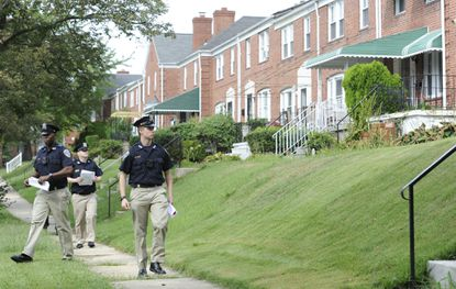 Baltimore Police department trainees distribute fliers as they walk along Northbourne Road in 2016 canvassing the area near the 5400 block of Loch Raven Blvd where Morgan State student Marcus Edwards, 21, was stabbed and later died from his wounds. File.