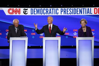Democratic presidential candidate Sen. Bernie Sanders, I-Vt., left, former Vice President Joe Biden and Sen. Elizabeth Warren, D-Mass., right, participate in a Democratic presidential primary debate hosted by CNN/New York Times at Otterbein University, Tuesday, Oct. 15, 2019, in Westerville, Ohio.