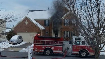 Approximately 40 firefighters responded to a house fire in Westminster on Thursday evening.