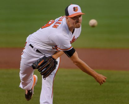 Baltimore, MD -- 08/23/2016 -- Baltimore Orioles starting pitcher Kevin Gausman delivers against the Washington Nationals at Oriole Park at Camden Yards. Baltimore swept the Nats in the two-game series, 8-1.