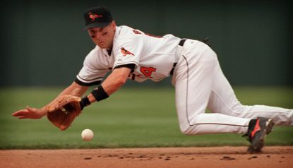Orioles shortstop Mike Bordick, lunging for a grounder hit by the Cleveland Indians' Travis Fryman on April 3, 2000, now serves as color analyst on Orioles broadcasts.
